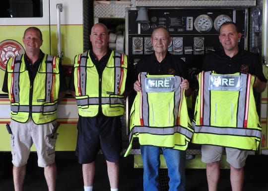 Travis Goodwill, Chad Hains, Chief Glenn Hill and Tony Griffith of the West Lafayette Fire Department with new reflective vests purchases with a donation of $800 from the West Lafayette Janusian Club.