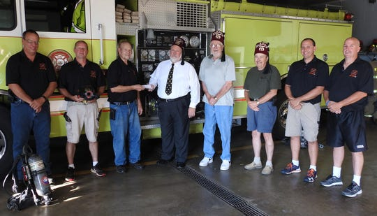 The Kambri Club of Cambridge of the Aladdin Shriners presented the West Lafayette Fire Department with a check for the purchase of thermal imaging cameras in face masks. The money will go with a donation last October for 10 cameras total. Pictured are Assistant Chief Damon Gould; Travis Goodwill, Chief Glenn Hill; Steve Hampton, Ronald LePage and Dick Bates of the Shriners; Tony Griffith and Assistant Chief Chad Hains.