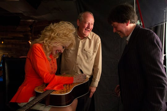 Country music star Dolly Parton is talking with director Ken Burns, and writer and producer Dayton Duncan.