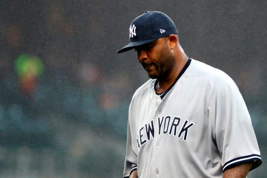 CC Sabathia walks off the field after being relieved in the fourth inning against the Tigers.