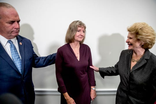 Rep. Dan Kildee, D-Mich., left, Sen. Debbie Stabenow, D-Mich., right, and Elizabeth Whelan, the sister of Paul Whelan, center, speak following a news conference on Capitol Hill in Washington, Thursday, Sept. 12, 2019, to call on Congress to pass a resolution condemning the Russian government for detaining Paul Whelan. (AP Photo/Andrew Harnik)