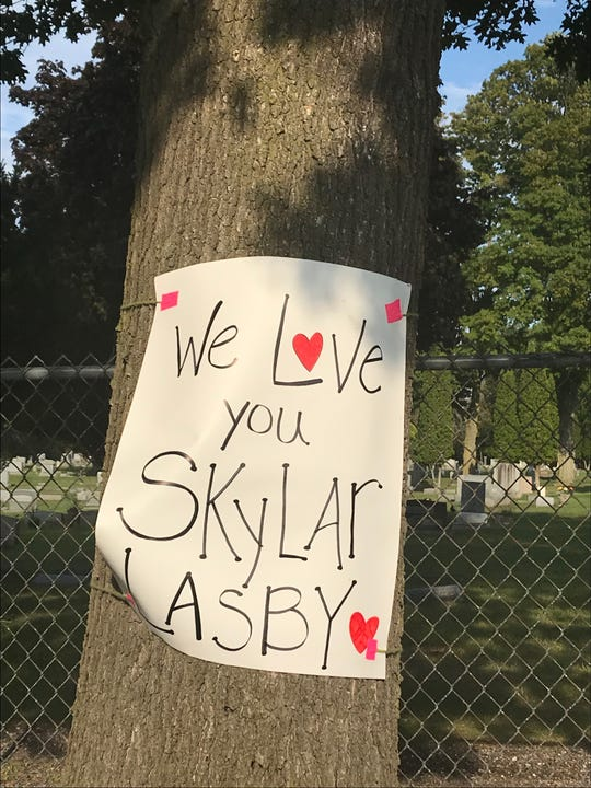A poster for Skylar Lasby on the school grounds in Saranac.