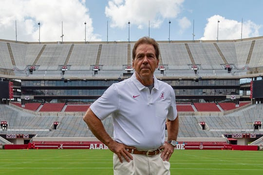 Alabama head coach Nick Saban prepares for a team coach photo prior to Alabama's fall camp fan-day NCAA college football scrimmage at Bryant-Denny Stadium in Tuscaloosa, Ala., on Aug. 3, 2019.