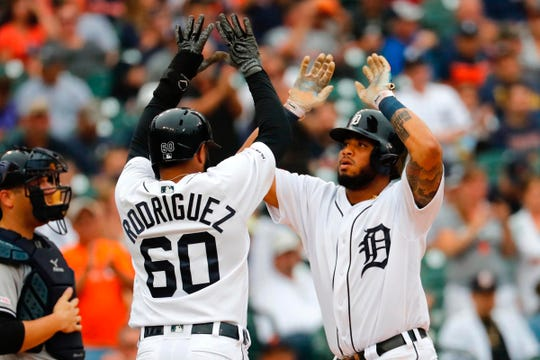 Detroit Tigers' Dawel Lugo, right, receives congratulations from Ronny Rodriguez after hitting a two-run home run in the fifth inning against the New York Yankees at Comerica Park, Thursday, Sept. 12, 2019.