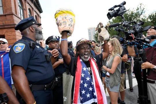 Demonstrators gather near the U.S. House Republican Member Retreat, Thursday, Sept. 12, 2019, in Baltimore, where President Donald Trump is speaking.