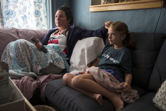 Alex Cellucci, 35, and her daughter, Maible, 6, watch a movie at their home in Quincy, Mass. on Tuesday, Aug. 6, 2019. Alex and Maible both have neurofibromatosis, a genetic disorder that causes tumors to form on nerve tissue. Alex was diagnosed with neurofibromatosis type 2 at age 28 and has since had two MRI scans done every year to monitor tumors. Most recently, Alex had a tumor removed behind her right eye on Aug. 5, 2019.