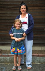 Alex Cellucci, 35, and her daughter, Maible, 6, pose for a portrait outside of their home in Quincy, Mass. on Tuesday, Aug. 6, 2019. Alex and Maible, both have neurofibromatosis, a genetic disorder that causes tumors to form on nerve tissue.