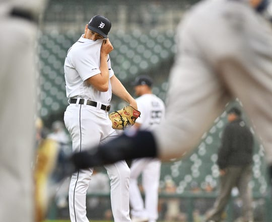 Tigers pitcher Spencer Turnbull wipes his face as Yankees' Aaron Judge rounds the bases on his two-run home run in the first inning.