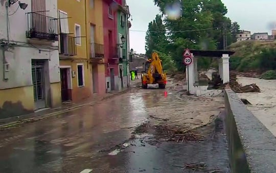 In this image made from video provided by Atlas, the flooded streets are seen in Ontiyente, Spain, Thursday, Sept. 12 2019.  A large area of southeast Spain was battered Thursday by what was forecast to be its heaviest rainfall in more than a century, with the storms wreaking widespread destruction and killing at least two people.