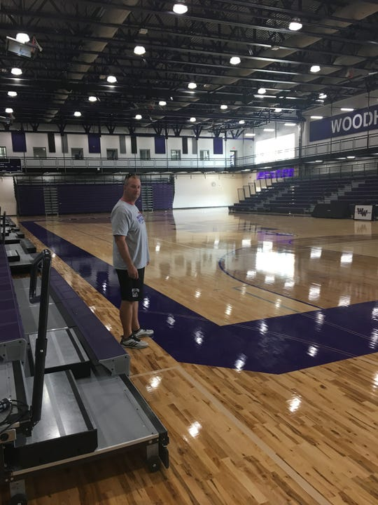 Woodhaven football coach Keith Christnagel stands in the school's new gym this week.