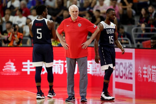 United States' coach Gregg Popovich, center, looks on near the United States' Donovan Mitchell , left and Kemba Walker during a consolation playoff game Thursday in the FIBA Basketball World Cup in Dongguan in southern China's Guangdong province.