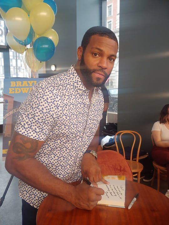 Former NFL star Braylon Edwards signing his book.