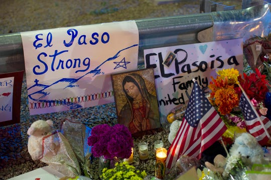 In this Aug. 4, 2019 file photo, a Virgin Mary painting, flags and flowers adorn a makeshift memorial for the victims of the mass shooting at a Walmart in El Paso, Texas.