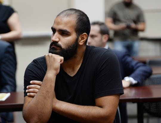 Ali Aljanabi, 23, of Dearborn listens during the press conference about the police investigation into the slaying of his sister, Saja Aljanabi.
