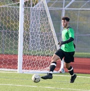 Elmira goalie Nate Burrows kicks the ball ahead during the Express' 2-1 win in boys soccer Sept. 11, 2019 at Ernie Davis Academy's Marty Harrigan Athletic Field.