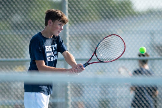 Reitz's Dylan Brown returns a shot from Memorial's Michael Zenni during their No. 1 singles match at Barker Sports Park Tuesday, Sept. 10, 2019.