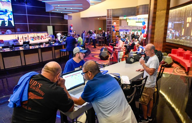 Sports gamers make their picks as the opening of the William Hill Sports Book at the Tropicana Evansville Thursday. The sports-book features a 16-by-9 feet video wall, ten 65-inch viewing monitors, and 12 odds boards, September 12, 2019.