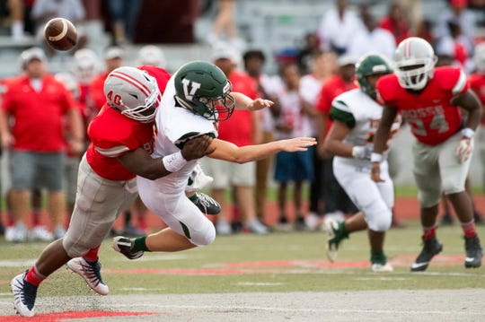 Bosse's Javonte' Madison, shown here makling a tackle against Vincennes in August, is one of several reasons the Bulldogs' defense has been better this season.
