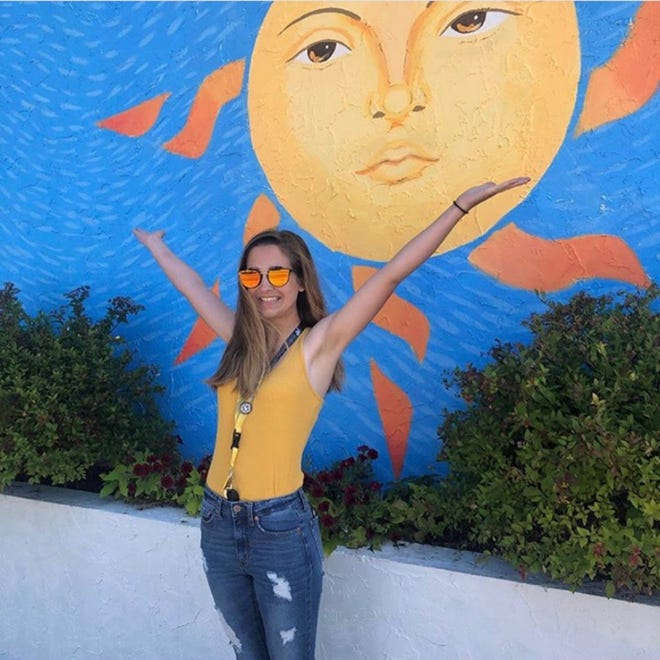 Sevastopol High School student Mackenzie Ellefson is shown in front of the mural she created for Egg Harbor restaurant Mojo Rosa's. Ellefson will be honored during a reception at the restaurant on Sept. 22.