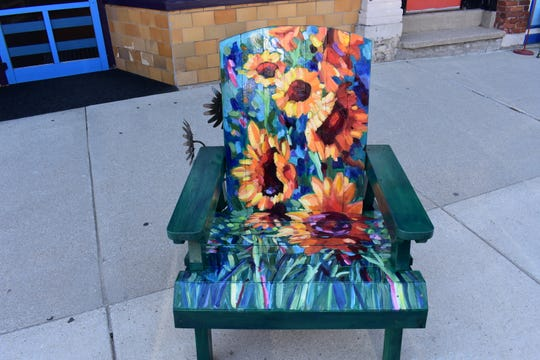 """Van Gogh Sunflowers"" by Nicole Herbst, one of the street art CHAIRries up for auction Sept. 21 as part of Sturgeon Bay Harvest Fest."