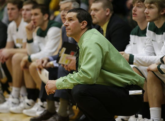 St. Norbert College men's basketball coach Gary Grzesk will coach against his alma mater, UWGB, next month.