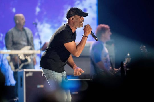 "Darius Rucker performs with Hootie and the Blowfish during the first of three shows in their hometown as part of their ""Group Therapy Tour"" at Colonial Life Arena Wednesday, Sept. 11, 2019, in Columbia, S.C. The band, on hiatus since 2008, formed in 1986 while the members attended the University of South Carolina."