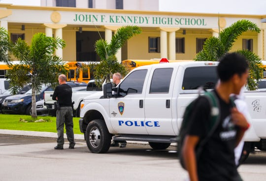 Officers of the Guam Police Department monitor the parking lot of John F. Kennedy High School as students board school buses and others are released on Thursday, Sept. 12, 2019. Earlier in the day, at about 11:40 a.m., the school was placed in a shelter-in-place status after multiple fights erupted in the cafeteria, said Isa Baza, Guam Department of Education spokesperson.