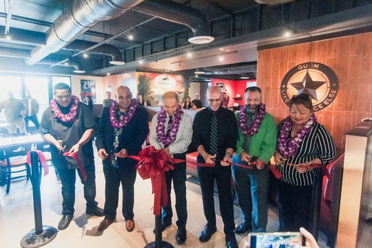The ribbon is cut for the opening of the new Chili's location in Tumon.