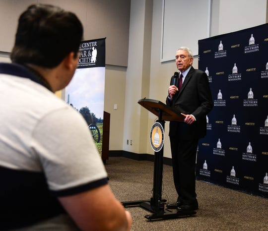 Dan Rather answers a question from Student Printz News Editor Caleb McCluskey during a press conference Thursday, Sept. 12, 2019.