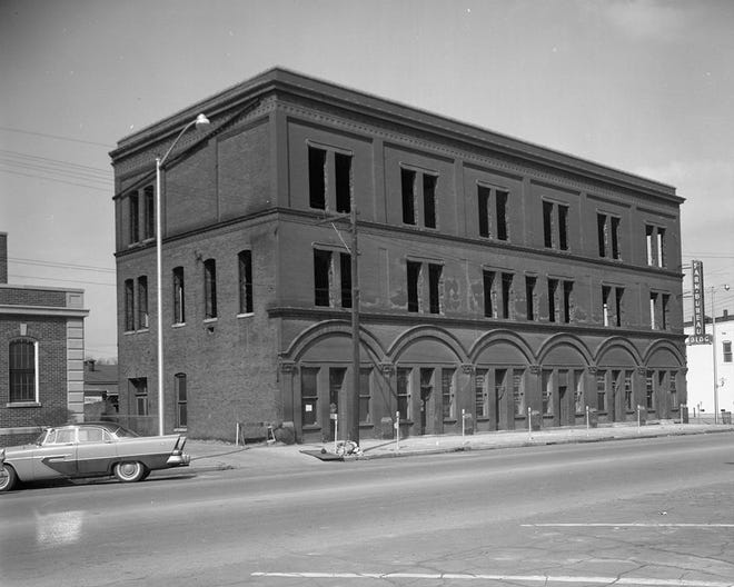 The Henderson County Farm Bureau occupied the old Nicholson building at First and Main Streets beginning in 1937 but in 1956 decided it was moving to new quarters. The building was stripped to a shell, as it appears here, and demolition took place between March and July 1958.