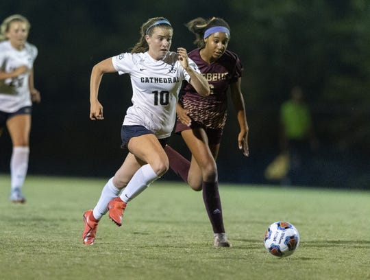 Cathedral High School senior Katherine Morris (10) and Brebeuf Jesuit Preparatory junior Gabi Arthur (6) during the second half of action in an IHSAA matchup of girls' soccer at Brebeuf Jesuit Prep, Wednesday, Sept. 11, 2019. Cathedral won 1-0.