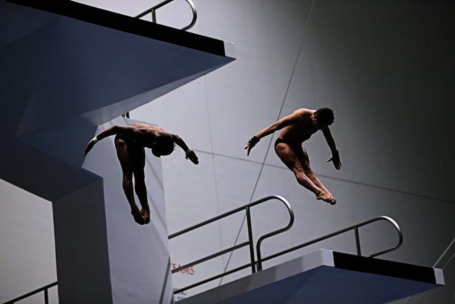 Jordan Windle and David Dinsmore dive during the synchronized men 10m platform event during the 2015 USA Diving Winter National Championship at the Natatorium at IUPUI on Dec. 16, 2015.