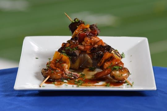Surf & Turf Kabobs – Grilled tenderloin of beef and citrus marinated grilled shrimp, skewered with chargrilled Tinkerbell peppers and BBQ glaze. Available at Lucas Oil Stadium for Indianapolis Colts games in 2019
