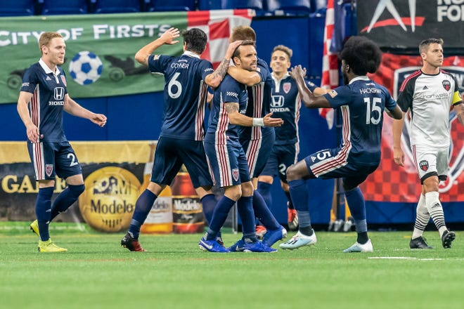Teammates mob Indy Eleven defender Ayoze in celebration of his first of two goals in a 2-0 win over Ottawa Fury FC at Lucas Oil Stadium. (Indy Eleven/Matt Schlotzhauer)