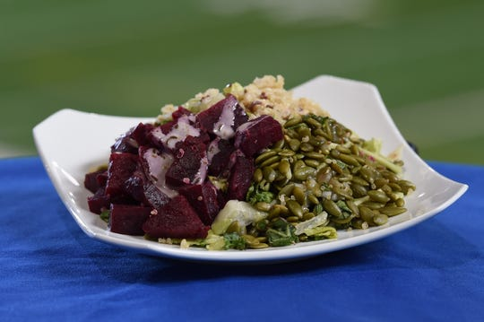 Beets and Greens Salad – Roasted beets with seasonal greens, quinoa, roasted pumpkin seeds and a light mustard vinaigrette. $8 at Lucas Oil Stadium during Indianapolis Colts games in 2019.