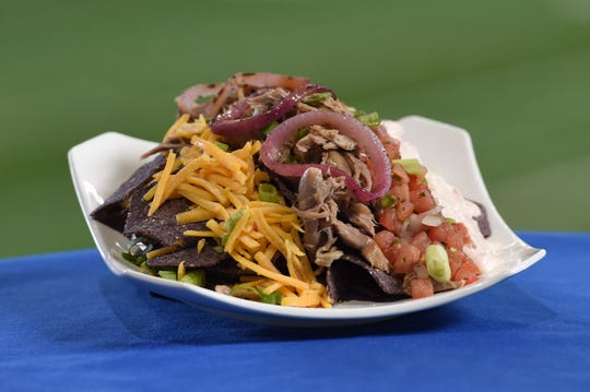 Shredded Duck Nachos – Shredded duck with blue corn tortilla chips, fresh pico de gallo, shredded cheddar cheese, charred red onion, green onion and sriracha sour cream. Available in suites at Lucas Oil Stadium for Indianapolis Colts games in 2019