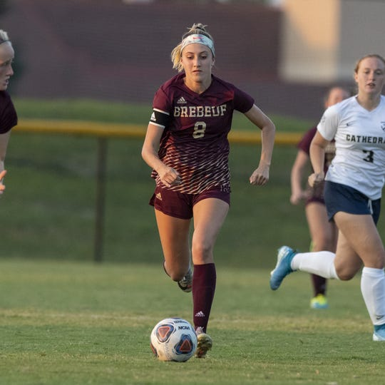 Brebeuf Jesuit Preparatory senior Sophie Weeter (8) dribbles the ball up field during the first half of action in an IHSAA matchup of girls' soccer at Brebeuf Jesuit Prep, Wednesday, Sept. 11, 2019.