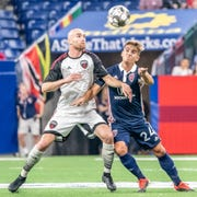 Indy Eleven forward Cristian Novoa battles Ottawa Fury striker Jeremy Gagnon-Lapare in the first half of Indy's 2-0 win at Lucas Oil Stadium.