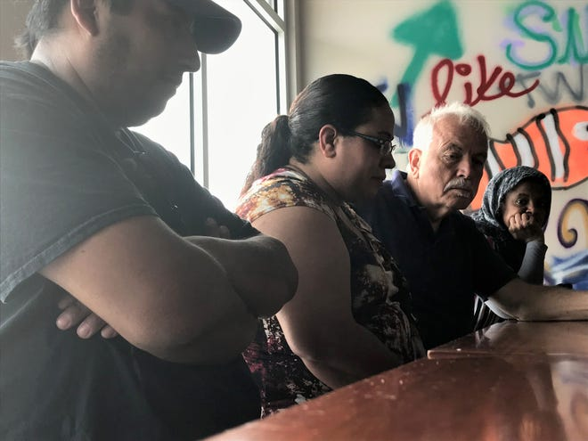 Wenceslao Mendez and Norma Diaz sat at a table in the North Liberty BeerBurger. The couple and former employees of the establishment were paid the wages they were owed on Thursday, September 12, 2019.