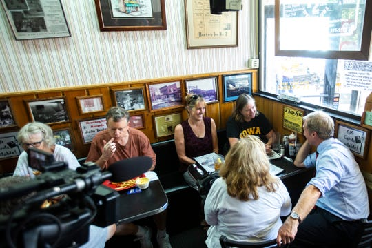 Democratic presidential candidate Tom Steyer meets with Carol Ferree, of Solon, while campaigning, Thursday, Sept. 12, 2019, at Hamburg Inn No. 2 in Iowa City, Iowa.