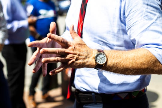 Democratic presidential candidate Tom Steyer talks with reporters about the lines on his left hand, Thursday, Sept. 12, 2019, at Hamburg Inn No. 2 in Iowa City, Iowa.