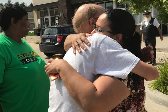 Norma Diaz was embraced as she walked out of the North Liberty BeerBurger having received the wages she was owed on September 12, 2019.