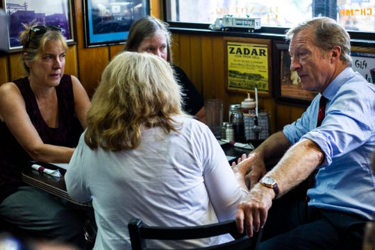 Democratic presidential candidate Tom Steyer meets with voters while campaigning, Thursday, Sept. 12, 2019, at Hamburg Inn No. 2 in Iowa City, Iowa.