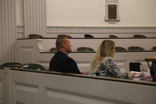 Scott Walters sits next to his attorney Veronica Gorman.