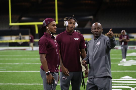 Mississippi State cornerbacks coach Terrell Buckley (far right) instructs freshmen corners Martin Emerson Jr. (middle) and Jarrian Jones (far left) during a walk through at Mercedes-Benz Superdome.