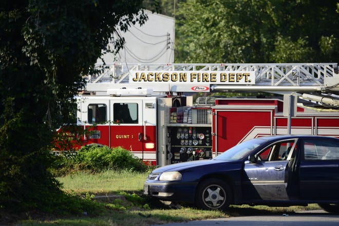 A Jackson Fire Department truck arrived on scene behind an apparently wrecked car on McCorry Street to assist Jackson police with a roof search of a nearby business on Sept. 12, 2019. The location of the sedan's driver is unknown.