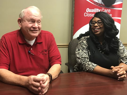 Faith Health Center Medical Director David Larsen and Christ Community Health Services CEO Shantelle Leatherwood share a laugh as they discuss future plans for the nonprofits during a press conference in Jackson, Tenn. on Sept. 11, 2019.
