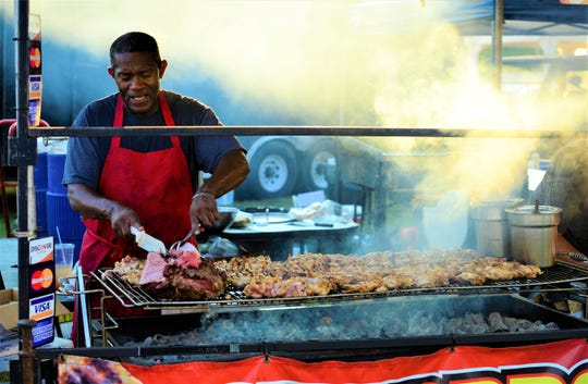 Kenneth Berkley slices up a roast at the West Tennessee State Fair at the Jackson Fairgrounds on Sept. 10, 2019.