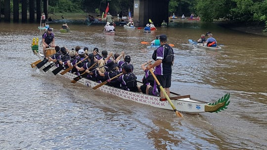 Dragon boat team at the Bayou Vermilion Boat Parade