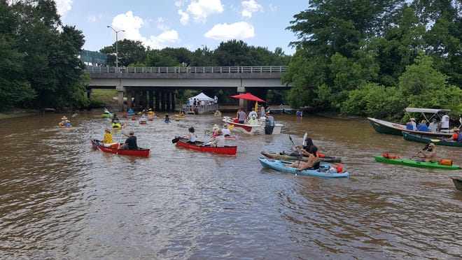 Motor boaters and paddlers during the Bayou Vermilion Boat Parade